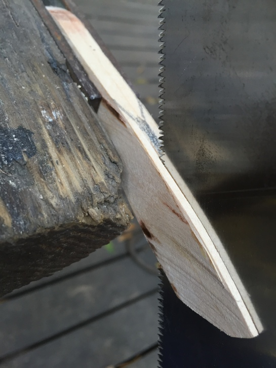 Clamp the knife in a vice, and cut on either side of the pencil line with a Japanese saw.